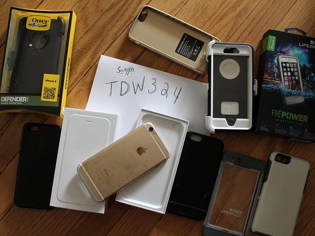 64GB Gold iPhone 6 with lots of cases-img_4722.jpg