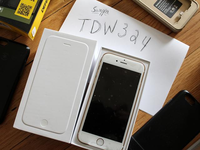 64GB Gold iPhone 6 with lots of cases-img_4721.jpg
